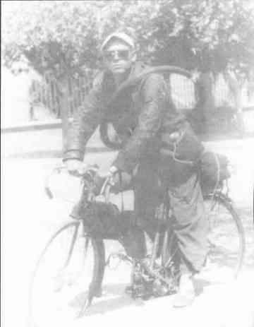 On the bicycle he would use to travel around Latin América.